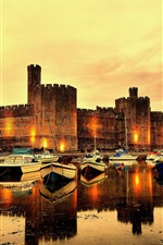Preview iPhone wallpaper Caernarfon Castle, fortress, river, boats, North Wales, UK