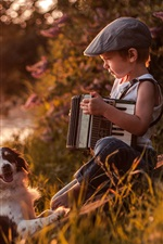 Preview iPhone wallpaper Child boy play accordion, furry dog, river, sunshine