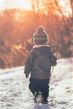 Preview iPhone wallpaper Child boy walk in the snow, winter, back view