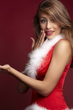 Menina de Natal, vestido vermelho, mãos posam