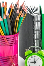 Preview iPhone wallpaper Colorful pencils, alarm clock, calculator, notebook, apple