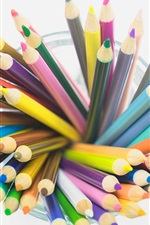 Colorful pencils, cup, white background