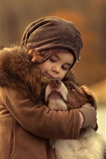 Preview iPhone wallpaper Cute child girl hug a dog
