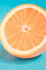 Preview iPhone wallpaper Fruit, half orange, water drops