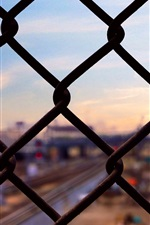 Preview iPhone wallpaper Grid fence, city
