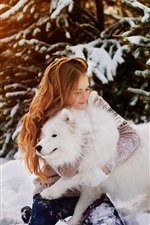 Preview iPhone wallpaper Happy girl and white dog in the snow, winter