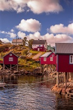 Norway, bay, red wood houses, water, clouds