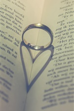 Preview iPhone wallpaper Ring, book, love heart shadow
