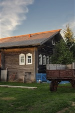Preview iPhone wallpaper Arkhangelsk oblast, village, houses, tractor, grass, Russia