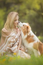 Preview iPhone wallpaper Blonde girl and dog, lawn, flowers