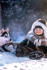 Preview iPhone wallpaper Child and husky dog in winter, snow