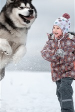 Preview iPhone wallpaper Child girl and dog play in the snow