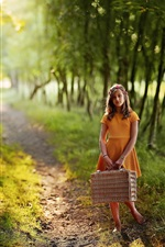 Preview iPhone wallpaper Child girl, orange skirt, suitcase, path, trees