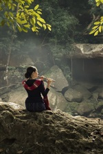 Preview iPhone wallpaper Chinese girl play flute, waterfall, tree, leaves