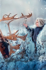 Cute child and deer in the winter