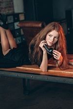 Preview iPhone wallpaper Girl use telephone, table, book