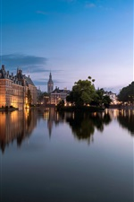 Preview iPhone wallpaper Hague, Netherlands, city, lake, buildings, trees, lights, dusk