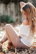 Preview iPhone wallpaper Happy blonde girl sit on ground, summer