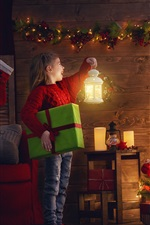 Preview iPhone wallpaper Happy child girl look at Christmas tree, lamp, holiday lights, gift, room