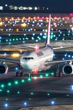 Preview iPhone wallpaper Japan, Kansai international airport, Airbus A330-200 plane flight, night