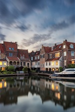 Preview iPhone wallpaper Netherlands, Enkhuizen, houses, lights, river, yacht, dusk