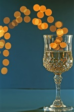 Preview iPhone wallpaper One glass cup of champagne, bright circles