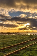 Preview iPhone wallpaper Railroad, grass, clouds, sunset