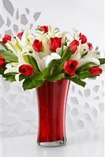 Red tulips and white lily, bouquet, vase
