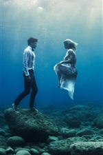 Preview iPhone wallpaper Underwater, boy and girl