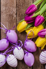 Yellow and purple tulips, eggs, Easter