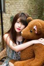 Preview iPhone wallpaper Young Asian girl and toy bear