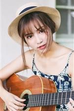 Vorschau des iPhone Hintergrundbilder Junges asiatisches Mädchen, das Gitarre spielt