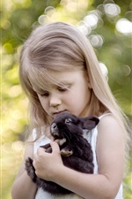 Preview iPhone wallpaper Blonde child girl and her pet black rabbit
