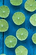 Preview iPhone wallpaper Green lemon, cut, blue background
