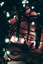 Preview iPhone wallpaper Holiday lights, hand, darkness