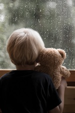Preview iPhone wallpaper Little boy and teddy bear look at window, rainy