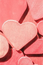 Many pink wooden love hearts
