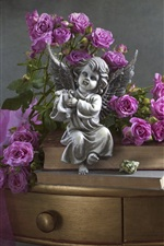 Purple roses, angel figurine, shells