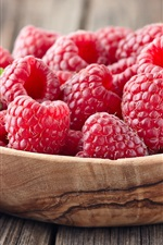 Preview iPhone wallpaper Red raspberry, wood bowl