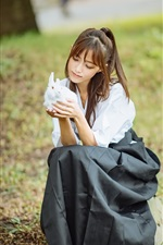 Preview iPhone wallpaper Asian girl and white rabbit