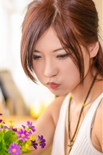 Preview iPhone wallpaper Asian girl look at purple flowers