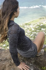 Preview iPhone wallpaper Asian girl sit on mountain top