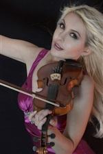 Blonde girl play violin, purple skirt, black background
