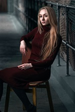 Blonde girl, sweater, chair