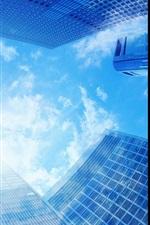 Blue sky, clouds, sun, glare, skyscrapers