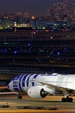 Preview iPhone wallpaper Boeing 787-9 passenger plane, airport, night, lights