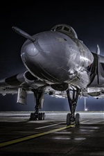 Combat aircraft front view, airport, night