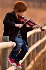 Preview iPhone wallpaper Cute child boy play violin