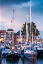 Preview iPhone wallpaper Dordrecht, Netherlands, yachts, port, city, lights, clouds, evening
