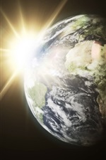 Preview iPhone wallpaper Earth, sun, light rays, space